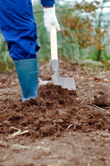 Close up of a man digging soil