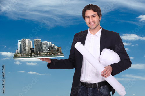 Engineer holding a model of a city