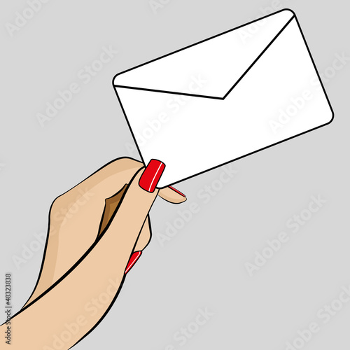 Womans hand holding an envelope