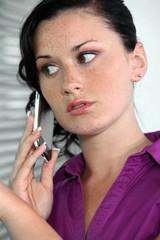 Anxious businesswoman making call