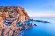 Leinwandbild Motiv Manarola village, rocks and sea at sunset. Cinque Terre, Italy