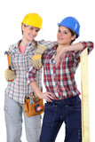Two young women laborers in workwear poster