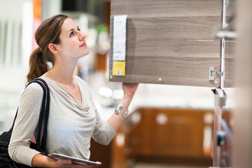 Young woman shopping for furniture in a furniture store
