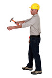 Man hammering an invisible object