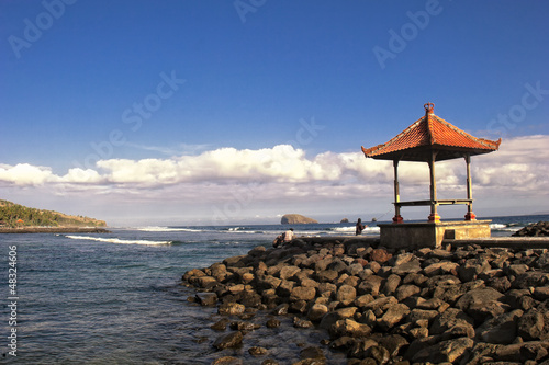 Stone pier on the beach at Candidasa, Bali