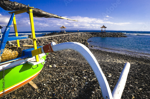 Outrigger fishingboat on the beach in Candidasa, Bali