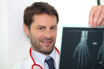 Doctor examining x-ray image of hand