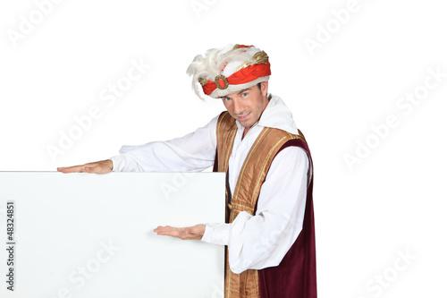 Man in Sultan Fancy Dress Costume with blank board