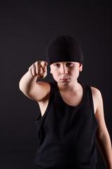 boy in black hat points the finger