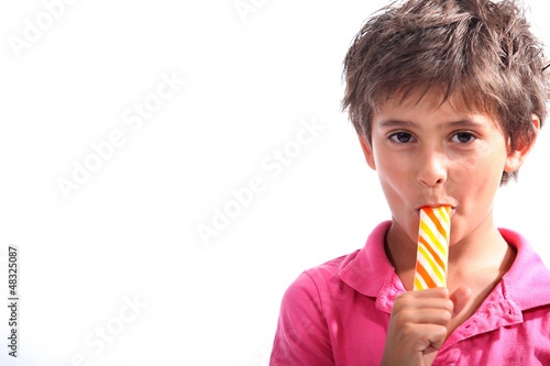 Boy sucking on a lollipop