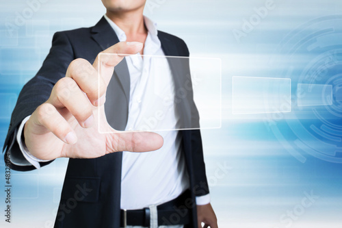 Businessman Holding Touchscreen In Hand