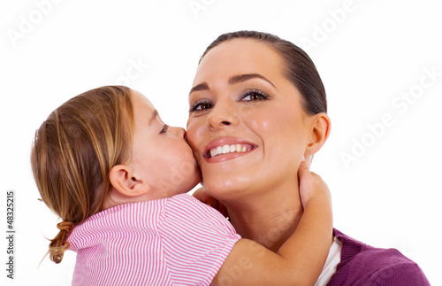 little daughter kissing mother isolated on white