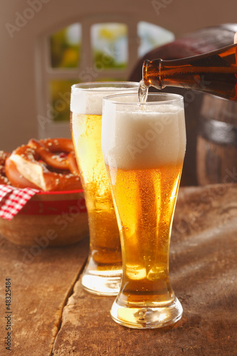 Pouring glasses of frothy beer