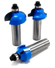 Group of three vividly blue wood router bits on white background