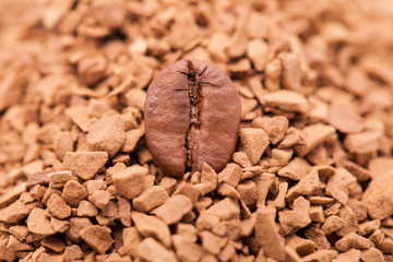 Coffee bean with instant coffee on background