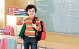 Student boy with a red backpack