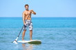 Stand up paddle board man paddleboarding
