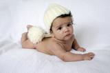 Newborn baby wearing a white hat