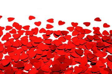 Red heart shaped confetti background or horizontal border