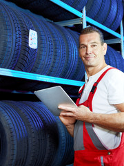 Master mechanic looking for the right tire with touchpad