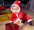 Little Santa boy with gift boxes.