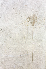 White wall with dry spilled dark paint