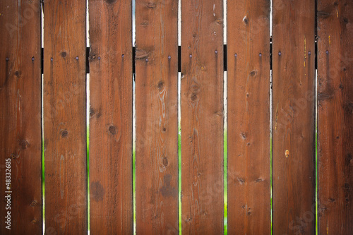 Brown fence with a bright blurred background