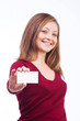 smiling woman holding blank card