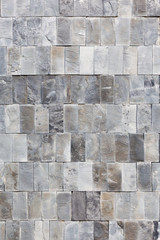 Tall shot of uneven marble tiles texture