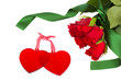 two glass hearts with red roses