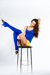 Full-length portrait of a woman with perfect body on chair