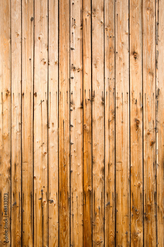 Weathered yellow fence from natural wood, portrait