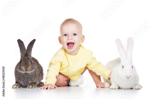 baby and rabbits
