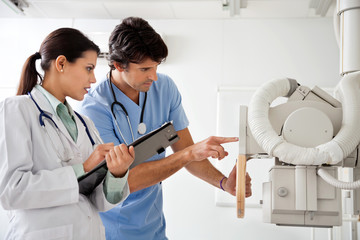 Radiologist And Technician Working At Clinic