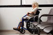 Pensive Elderly Woman On Wheelchair