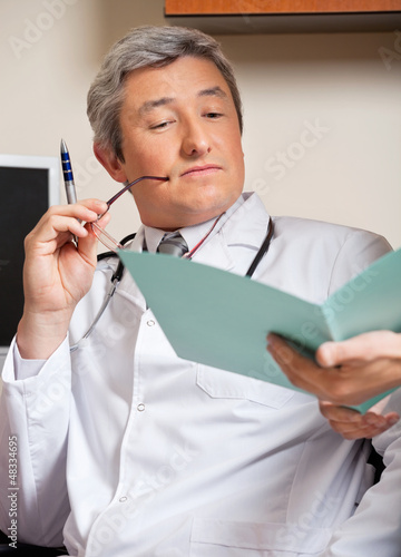 Doctor Reading Medical Report