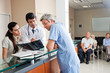 Doctors Reviewing X-ray At Reception