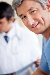 Mature Male Doctor Smiling