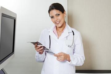 Female Radiologist Holding Sonography Print