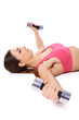Woman working out using dumbbells