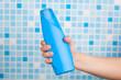hand holding shower gel