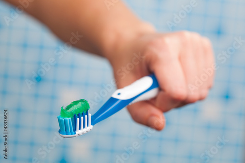 toothbrush in hand