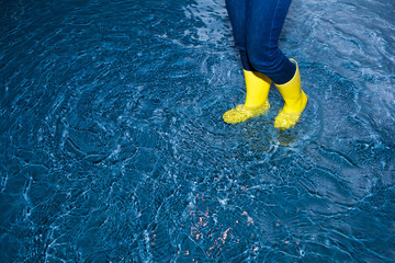 rubber boots walking in the water