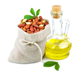 Sack of peanut and glass bottle of oil with leaves