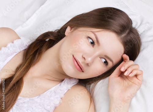 beautiful  woman asleeping in a bed