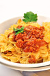 italian pasta - farfalle with meat and tomato sauce