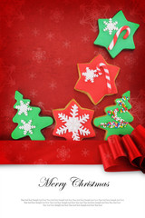 Christmas card with cookies on fabric background