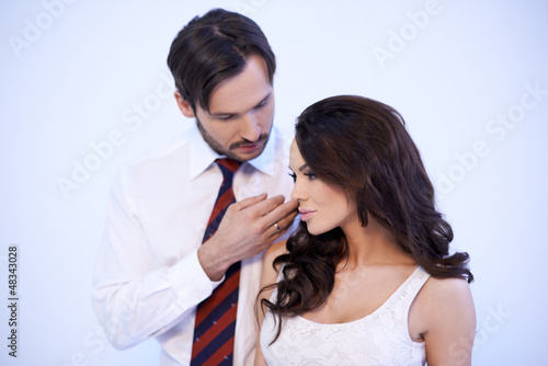 Loving man stroking a womans cheek