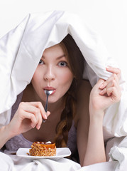 girl on diet eating spoon
