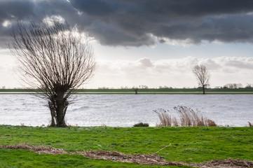 Dramatic clouds above a Dutch river